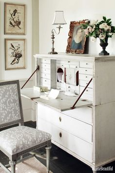 Love the gray painted chair and gray and white chair seat upolstery. Mick Hales  - HouseBeautiful.com