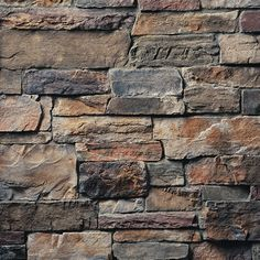 Exterior stone santa fe i like the grey and brown for Boral siding cost
