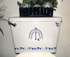 From the Primitive decal designs in the Country Collection. This one shown in Medium Blue and Metallic Silver.