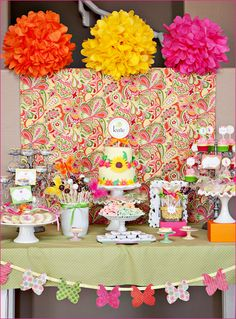 "cake/cupcake pedestals, ""pom pom"" flower bouquets, paisley patterns, etc."