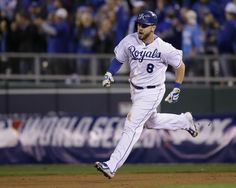 Kansas City Royals Mike Moustakas runs the bases after a solo home run in the seventh inning of Game 6 of baseball's World Series Tuesday, Oct. 28, 2014, in Kansas City, Mo. (AP Photo/Charlie Neibergall)