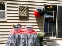 Outdoor drink station for Tess's Graduation party. Galvanized tubs for water and beer. Used a large roll of zebra plastic table covering to make the ruffled skirt for the table. Thank you Pinterest!