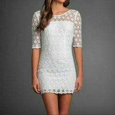 NWOT Abercrombie & Fitch Crocheted Mini Dress Brand new and unworn crocheted mini dress with elbow length sleeves, from Abercrombie & Fitch. Dress is 100% cotton and has an interior lining. The tags have been removed but the dress has never been worn and is in perfect condition. Size 6 - fits like a size small. Abercrombie & Fitch Dresses