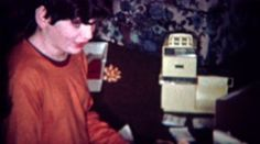 1970: Boy gets basketball hoop for Christmas gift. BOULDER, COLORADO. http://www.pond5.com/stock-footage/58805267?ref=StockFilm keywords:holiday, christmas, gift, excited, sports, equipment, joy, happiness, son, Easy Bake Oven, living room, proud, fitness, NBA, ncaa, opening gifts, 1970, Boy, gets, basketball, hoop, Christmas, 1960s, 8mm, film, old, tv, commercial, past, home movie, vintage, style, retro, rare, unique, archive, nostalgia, sentimental, memories, throwback, Americana…