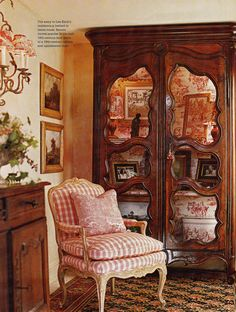 Like the red Toile de Jouy fabric at back of armoire; and i love, Love, LOVE red toile together with red plaid! ~ karyn