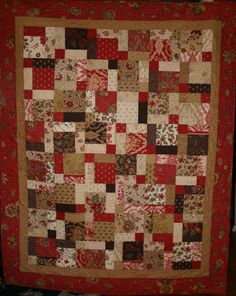 Traditional Patchwork Lap Quilt in Rich Reds, Caramels, Creams and Browns. $165.00, via Etsy.