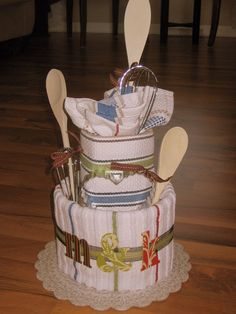 A nappy cake alternative for a chef in training. Using tea towels, aprons, pot holders and utensils etc