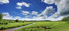Summer Panorama by SERHII KUCHER FINE ART PHOTOGRAPHY.  Wonderful panoramic landscape of the sunny river valley with blue sky and clouds. #SerhiiKucherFineArtPhotography #RiverValiey #SummerTime #Clouds #FineArtLandscapes #ArtPrints  #HomeDecor
