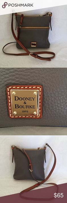 "Dooney and Bourke Leather Crossbody Satchel Excellent condition. Beautiful elephant gray color Dooney & Bourke leather crossbody satchel with rich red interior. 3 inner pockets: two open, one zipper closure. One outer zipper pocket. Key clip removed (see picture). Dimensions: 8.5"" tall, 9"" wide, 1.5"" base. Dooney & Bourke Bags Crossbody Bags"