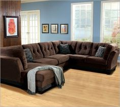 Love The Blue Walls With Brown Couch Especially The Wall Decor