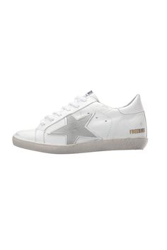 Low top sneakers with a star patch, rubber sole, round toe, lace up styling, padded insole and hand distressed detailing.    Steven Low Top Sneakers by Freebird by Steven. Shoes - Sneakers - Low Top Manhattan, New York City