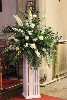 church wedding flower arrangment | ivory and blue pedestal arrangement
