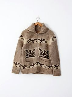 A vintage hand-knit cowichan sweater. The thick wool sweater features a thunderbird eagle pattern in natural wool tones and a zipper closure. - cowichan sweater - zip up closure cardigan - thick wool Fair Isle Knitting, Baby Knitting, Cowichan Sweater, Chunky Cardigan, Sweater Shop, Sweater Vests, Sweater Making, Jacket Pattern, Wool Sweaters