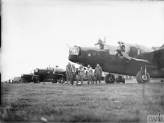 An aircrew of No. 149 Squadron RAF gather by the nose of their Vickers Wellington Mark IC, lined up with other aircraft of the Squadron at Mildenhall, Suffolk, before a night raid to Hamburg, Germany. Air Force Bomber, Air Force Aircraft, Ww2 Aircraft, Military Aircraft, Fighter Pilot, Fighter Jets, Wellington Bomber, Ww2 Pictures, Ww2 Planes
