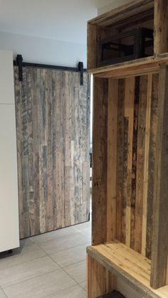 Hall way in the basement. Let's add functional storage space and a little bit of privacy... With reclaimed wood please!