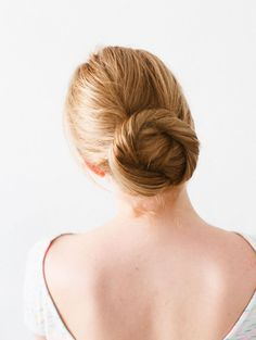 Easily twist your hair into a bun for a gorgeous winter look.