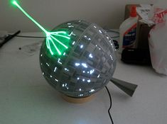 I need this!! I need this in my life and house!!! Death Star Christmas tree topper.