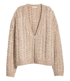 Beige melange. Wide-cut, slightly shorter cardigan in a soft cable knit with wool content. V-neck, zip at front, and dropped shoulders. Ribbing at neckline