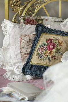 Lovely needlepoint and lace pillows.