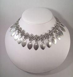 Chainmaille necklace. Hang etched pieces from the chain instead of scales?
