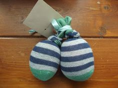 Make stress balls out of baby socks. Great kids activity for Fathers Day Gift.