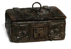 A FRENCH WALNUT AND IRON MOUNTED CASKET  16TH CENTURY. Carved with roundels and fluted pilasters
