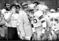 Coach Tom Landry of the Dallas Cowboys sends in a play alongside running back Preston Pearson in Super Bowl XII, Jan. 15, 1978, in New Orleans. The 1977 Cowboys went 8-0 and continued on to beat the Denver Broncos 27-10 in the Super Bowl.