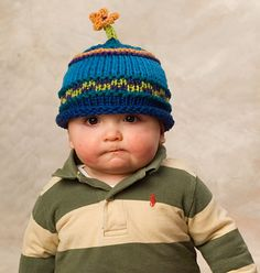 """Free pattern - Flower Power Hat    I don't know which is cuter...the hat or the fact that the little guy's face says """"Ummm...get this thing off me."""" #knitting #pattern #hat"""