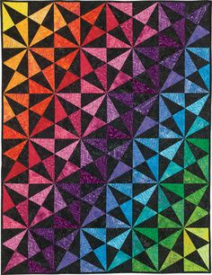 """This modern triangular paper-piecing pattern includes three different sizes: Venti (72"""" x 97""""), Grande (54"""" x 75"""") and Tall (36"""" x 54""""). DIg into your scrap bins and stash to make this fresh and detailed triangle quilt pattern!  You will needLetter-Size Foundation Papersto make this quilt. Find themhere!"""