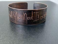 All You Need is Love copper etched cuff bracelet $55   ~ This is so sweet - we used this song for our wedding <3