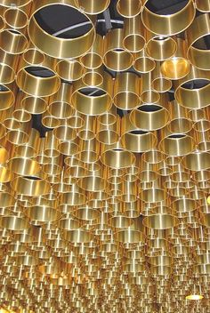 Ceiling of the Business Club in the Allianz Arena, a football stadium in Munich, Germany, designed by CBA Clemens Bachmann Architekten - #modern #contemporary #ceiling #design #idea #interior #solution #architecture #brass #gold #tube #pipe #cylinder