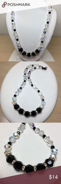 "Vintage Aurora & Black Genuine Crystal Necklace A vintage 18"" Aurora Borealis and Black crystal necklace, accented with rhinestone rondelle beads. Strung on the original beading string and the original brass clasp is still intact. A great piece for a wedding or for Prom! In excellent vintage condition. A sparkling beauty! Vintage Jewelry Necklaces"