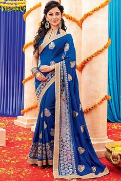 Blue Georgette Saree with Dupion Silk Blouse Andaaz Fashion new arrival Blue Georgette Saree with Dupion Silk Blouse and Designer Pallu. Embellished with Resham work. Sari comes with designer Sleeveless and stylish Round Neck Blouse. This is prefect for Party, Wedding, Festival, Ceremonial.