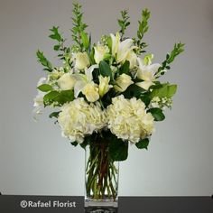 all white elegant design in a clear vase. This floral arrangement features imported premium hydrangeas, scented white lilies, and roses. Send it today! Funeral Floral Arrangements, White Floral Arrangements, White Flowers, White Lilies, Fresh Flowers, Beautiful Flowers, Lily Centerpieces, Diy Wedding Flowers, Tulip Wedding