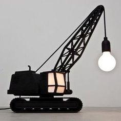 OMG what a good idea.  Spray paint a cheap truck toy and add a lightbulb/wiring and shade?