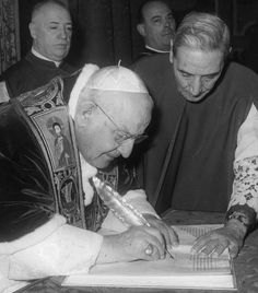 Pope John XXIII signs the bull convoking the Second Vatican Council on October 11, 1962.