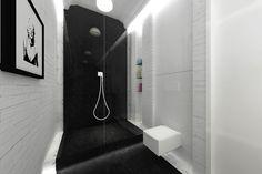 Projekt wnętrz eleganckiej łazienki wykończonej kamieniem - Tissu. Ekskluzywna łazienka z dużym przeszklonym prysznicem wykończonym czarnym kanieniem i cegłą. Podświetlony stopień sprawia wrażenie że prysznic unosi się nad podłogą. Czerń przez środek wygląda jak dywan wywijający się na ścianę. Całość bardzo elegancka. http://www.tissu.com.pl/zdjecia/391