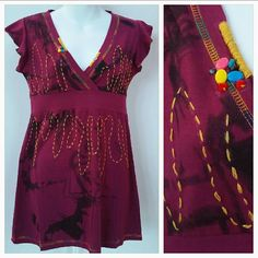 "Detailed Top New with tags  Urban Chic top features Vneck, threaded detailed, beaded details, black with pinkish burgundy color and black. Multi colors threading. Woven threaded design on front  Length approx 28"" Bust approx 17"" Medium  ***at the left corner of the sleeve there is a place where the top didn't fully get dyed, this happened during the manufacturing process, due to the defect  this item will be offered at a discount. Sold as is.** pic 4 Tops"