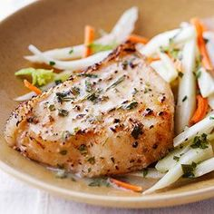 Sea Bass (maybe chicken?) with Fennel Slaw This heart-healthy fish dinner owes its sensational flavor to a double dose of fennel--fresh strips in the slaw and seeds in the coating for the fish.