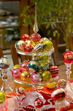 Great idea for a centerpiece,....vintage ornaments on stacked cake stands.