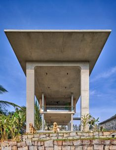 The house combines a range of architectural forms and motifs, including arched doorways, oak shutters, colonnade-style columns, a floating staircase and overhanging roof slabs. Floating Staircase, Concrete Houses, The Embrace, Artistic Installation, Ground Floor Plan, Tropical Landscaping, Building Structure, Environment Concept Art, Puertas