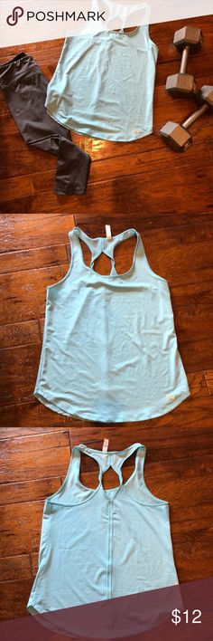 Under Armour Heat Gear workout top Under armor Heat Gear workout top. Light blue. Racer back style with twist detail. Like new condition. Size small.  Listing is for top only. But, the pants in the first picture are also listed in my closet. Under Armour Tops Tank Tops