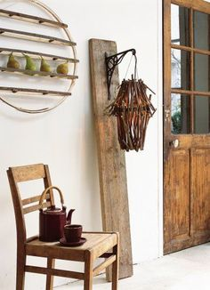 like the rustic board with planter hook...perhaps a mason jar candle hanging instead??