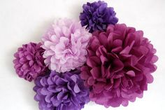 Suspend this bold and bustling collection of floral tissue paper poms in lilac and purple at your wedding