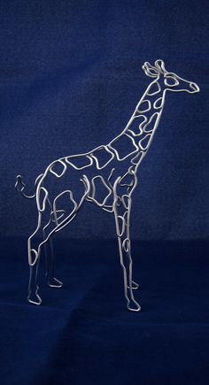 A three dimensional wire Giraffe hand crafted from a single piece of aluminum wire, measuring about 7 inches tall. All sculptures are made to