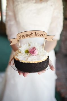 Sweet, sweet love cheesecake with a topper from http://www.etsy.com/shop/betteroffwed  Photography by saralucero.com