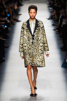Dell'Acqua finished with some show-stopping coats that showed his hand at embellishment: a grouping of shirts, a dress and coat completely bedazzled in gold embroidery and beads.   - HarpersBAZAAR.com