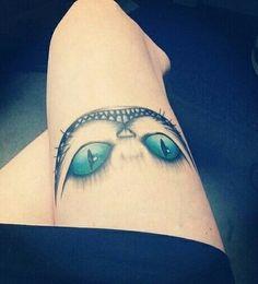 Cheshire cat tattoo, thigh tattoo, Alice in Wonderland tattoo