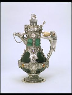 """1865-1866 British Decanter at the Victoria and Albert Museum, London - From the curators' comments: """"The architect and designer William Burges (1827-1881) designed several decanters (decorative vessels for serving wine at the table) similar to this one. These included two for use in his own home, Tower House in Kensington, London, as shown in contemporary photographs. Burges looked to the arts of China, Assyria, ancient Greece and Rome, and medieval Europe as inspiration for this design."""""""