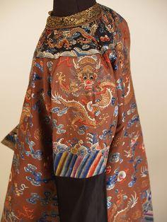 Sleeve detail on semi-formal robe of brown brocaded silk, Chinese, 19th century, KSUM 1983.1.758.